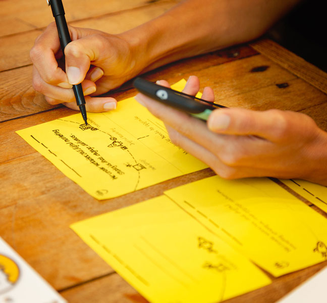 Woman writing on yellow sticky notes